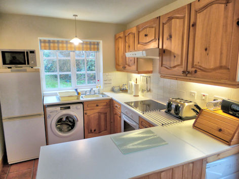 Kitchen with microwave oven, full-size dishwasher, washing machine & tumble dryer